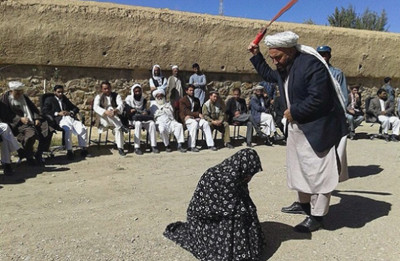ghor public lashing girl adultery warlords afghanistan