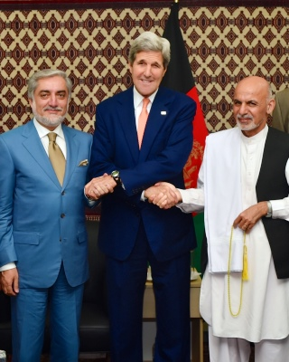 John Kerry shakes hands with Afghan presidential candidates Abdullah Abdullah and Ashraf Ghani August 2014 1