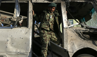 soldier in suicide attack site afghanistan