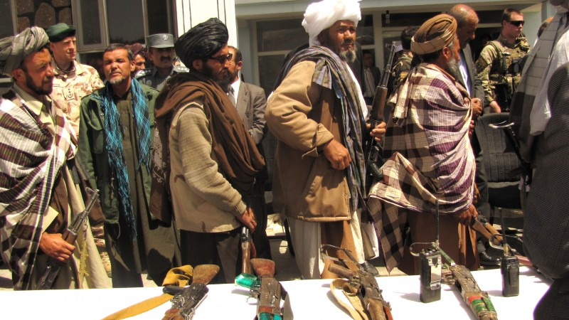 Former Taliban fighters return arms